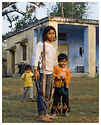Girl with shotgun and younger brothers. Corbett National Park, Himashal Pradesh, India.