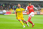 Danny Andrew of Fleetwood Town (3) clears away from Luke O'Neill of AFC Wimbledon (2) during the EFL Sky Bet League 1 match between Fleetwood Town and AFC Wimbledon at the Highbury Stadium, Fleetwood, England on 10 August 2019.