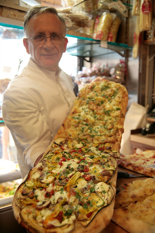 Volpetti, Via Marmorata, Shop owner Emiliano Volpetti holding pizza, Rome, Italy, Frommer's Italy Day By Day