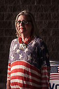 """HOOVER, AL – MARCH 1, 2016: Deanie Coe, 66, stands outside the Hunter Street Baptist Church polling station, where she cast her ballot for Donald Trump. """"He's tough and he's strong,"""" Coe said, """"and I feel like he's going to stand up for America. The country needs to be fixed. Washington is broken and I'm ready for a change. I don't like all the in fighting on the Republican Party but we have some strong candidates out there that will stand up. Christians need to take a stand, and one candidate in particular says he's going to put Merry Christmas back in the Whitehouse. I really like that. I like that fact he said he was going to send out Christmas cards.""""<br /> <br /> On Super Tuesday, voters in the economically vibrant city of Hoover turned out to voice their support for a presidential candidate. Located in the Appalachian foothills, Hoover is the largest suburb of Birmingham and is home to several planned communities with idyllic neighborhoods tailored for the upper middle class. CREDIT: Bob Miller for The Wall Street Journal<br /> OLDCITIES"""