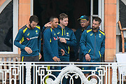 Michael Neser, Usman Khawaja, Steve Smith and Matthew Wade of Australia on the team balcony as the rain stops during the International Test Match 2019 match between England and Australia at Lord's Cricket Ground, St John's Wood, United Kingdom on 14 August 2019.