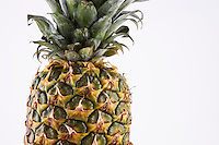Close-up of fresh pineapple over white background