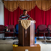 OCTOBER 18 - LARES, PUERTO RICO - <br /> Eugenio Beniquez, 46, a pastor from the  Seburuquillo neighborhood in Lares cries as he stands behind the dais in his small church and talks about his upcoming move to Florida following the destructive path of hurricane Maria.<br /> (Photo by Angel Valentin for NPR)