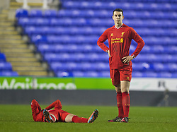 READING, ENGLAND - Wednesday, March 12, 2014: Liverpool's Jordan Williams looks dejected after losing 5-4 on penalties after a 4-4 draw against Reading during the FA Youth Cup Quarter-Final match at the Madejski Stadium. (Pic by David Rawcliffe/Propaganda)