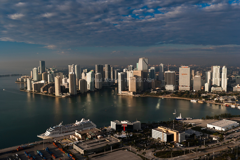 Aerial view of Downtown Miami Skyline and the mouth of the Miami River in early morning showing cruse ships at the Port of Miami.