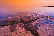 Dusk on rocky shore of Lake Erie<br /> Selkirk<br /> Ontario<br /> Canada
