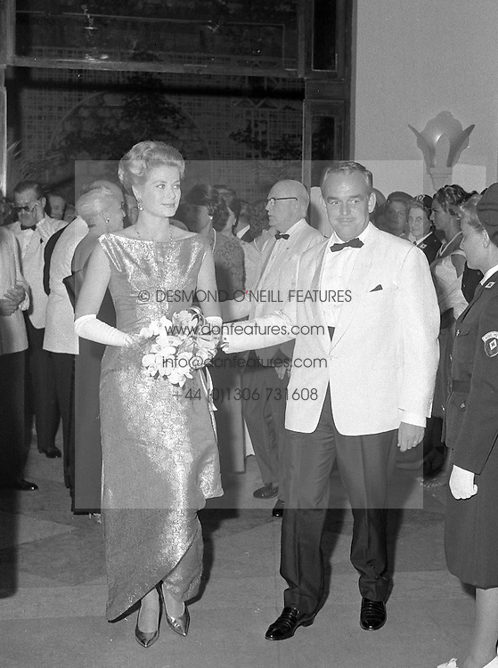 PRINCE RAINIER & PRINCESS GRACE OF MONACO at the Monte Carlo Red Cross Ball,  Monaco in August 1961.