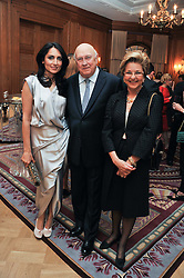 Left to right, RENU MEHTA, former South African President F W de KLERK and his wife ELITA GEORGIADES at the 4th Fortune Forum Summit held at The Dorchester Hotel, Park Lane, London on 4th December 2012.