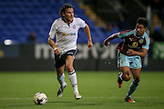 Lawrie Wilson (Bolton Wanderers) runs past Josh Ginnelly (Burnley) during the Pre-Season Friendly match between Bolton Wanderers and Burnley at the Macron Stadium, Bolton, England on 26 July 2016. Photo by Mark P Doherty.