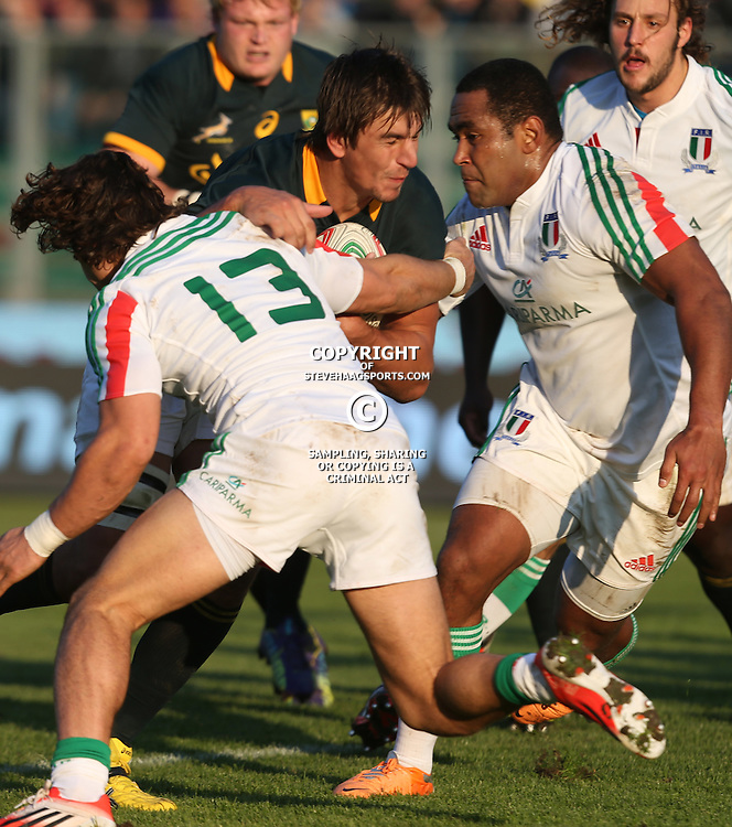 PADUA, ITALY - NOVEMBER 22: Eben Etzebeth of South Africa on attack as he is tackled by Michele Campagnaro of Italy during the Castle Lager Outgoing Tour match between Italy and South African at Stadio Euganeo on November 22, 2014 in Padua, Italy. (Photo by Steve Haag/Gallo Images)