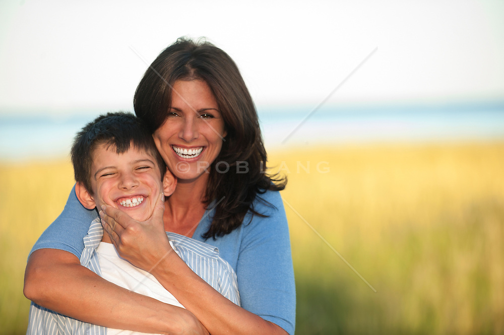 mother and son smiling and enjoying time together outdoors