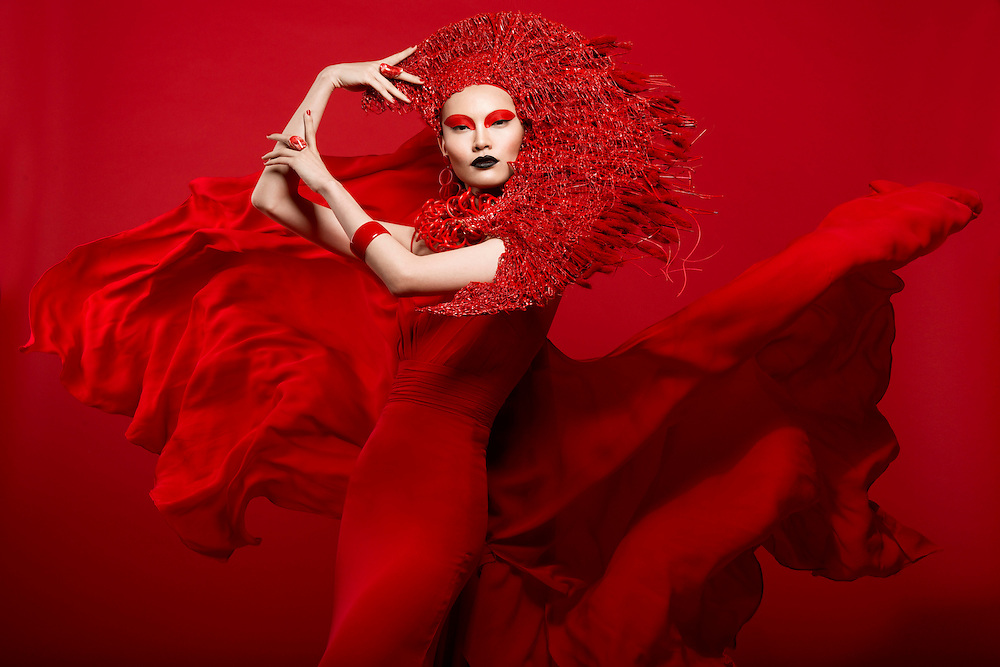 Avant garde red fashion editorial by Lindsay Adler Photography, New York Fashion Photographer. Fan headpiece by Posh Fairytale Couture.