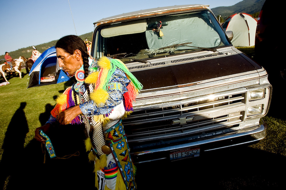 JEROME A. POLLOS/Press..Joe Sam Scabbyrobe, a Blackfeet Tribe member from Browning, Mont., puts the finishing touches on his regalia before taking part in Friday's grand entry.