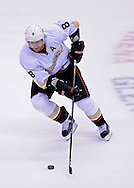 Mar. 2, 2013; Glendale, AZ, USA; Anaheim Ducks forward Teemu Selanne  (8) handles the puck in overtime play against the Phoenix Coyotes at Jobing.com Arena. The Coyotes defeated the Ducks in a shootout 5-4. Mandatory Credit: Jennifer Stewart-USA TODAY Sports