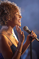 Jazz singer on stage side view