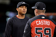 Jul 24, 2017; Phoenix, AZ, USA; Atlanta Braves infielder Johan Camargo (17) listens to assistant hitting coach Jose Castro (59) during batting practice between the game against the Arizona Diamondbacks at Chase Field. Mandatory Credit: Jennifer Stewart-USA TODAY Sports