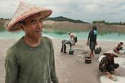 Darman (53 years) has been a miner since 22 years. He earns 6 Euros a day.  Most mines are exploited illegally and accidents occur often. Tin mine on the road to Pemali. Bangka Island (Indonesia) is devastated by illegal tin mines. The demand for tin has increased due to its use in smart phones and tablets.<br /> <br /> Darman (53 ans) a été  mineur depuis 22 ans et il gagne 6 euros par jour. La plupart des mines sont exploitées illégalement et les accidents se produisent souvent. Mine d'étain sur la route de Pemali. L'île de Bangka (Indonésie) est dévastée par des mines d'étain sauvages. La demande de l'étain a explosé à cause de son utilisation dans les smartphones et tablettes.