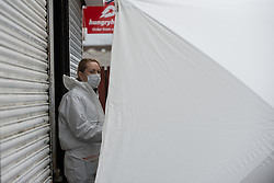 &copy; Licensed to London News Pictures. 25/03/2016. <br /> <br /> Pictured: A Police Scotland Crime Scene Investigator at Delicious Deli, Clydebank. <br /> <br /> Police Scotland have focused the centre of the murder investigation of 15 year old Paige Doherty in Clydebank, Glasgow around the home and business premises of suspect John Leathem as they search his house and Delicious Deli near Fleming Street, Clydebank Glasgow on Friday 25th March 2016.<br /> <br />  Photo credit should read Max Bryan/LNP