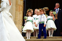 Bridesmaids and page boys, including Princess Charlotte and Prince George, walk down the West Steps after the wedding of Princess Eugenie to Jack Brooksbank at St George's Chapel in Windsor Castle.
