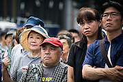 People listen the speech of Hiroya Masuda, a major candidate for Tokyo gubernatorial election in Ginza,Tokyo. The former internal affairs minister has the backing of the Liberal Democratic Party, Komeito and the Party for the Japanese Kokoro in the July 31 election. 18/07/2016-Tokyo, JAPAN