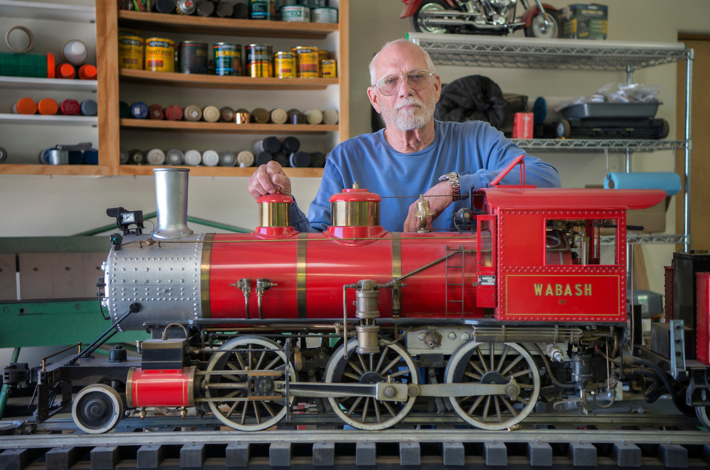 em042117c/living/Jack Harris poses with his fully working 500 lb. model of a F4 Walbash steam engine. The train is in his workshop at him home in Santa Fe, Friday April 21, 2017. (Eddie Moore/Albuquerque Journal