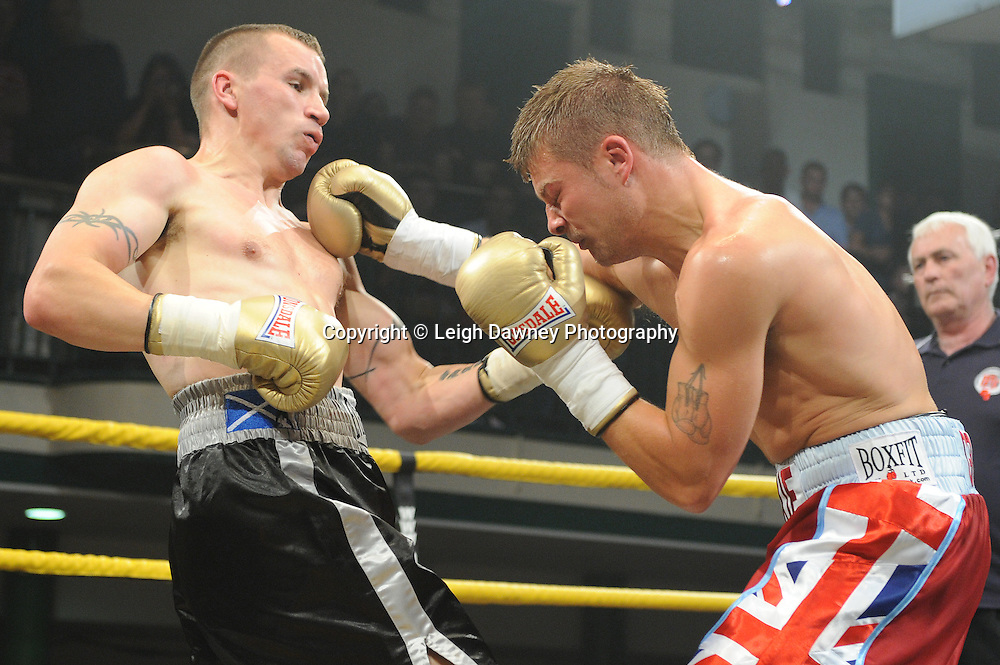 John Wayne Hibbert  in Union Jack shorts is defeated by Kevin McIntyre at Quarter Final One at Prizefighter Welterweights II,York Hall, Bethnal Green ,London. Matchroom Sport/Prizefighter.Photo credit: Leigh Dawney 2011 07.06.11