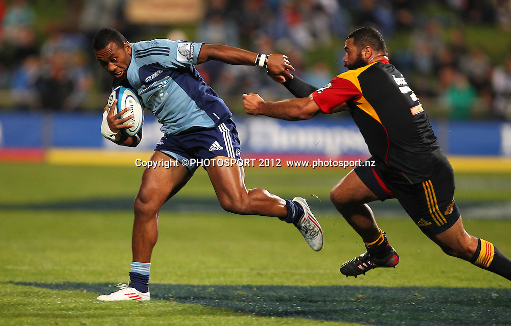 David Raikuna of the Blues gets away from Ben Afeaki of the Chiefs during the Super Rugby game between The Blues and The Chiefs, North Harbour Stadium, Auckland, New Zealand, Saturday June 2nd 2012. Photo: Simon Watts / photosport.co.nz