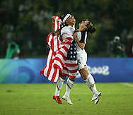 BEIJING, CHINA: Two USA women soccer players  celebrate after winning the gold medal at the 2008 Summer Olympic games in Beijing,China on Thursday,8/21/08. ©2008 Johnny Crawford