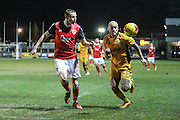 Paul Mullin of Morecambe FC and David Pipe of Newport County during the EFL Sky Bet League 2 match between Newport County and Morecambe at Rodney Parade, Newport, Wales on 21 February 2017. Photo by Andrew Lewis.