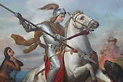 St George and the dragon, detail of the saint in armour on horseback holding his spear, Neoclassical oil painting on canvas, 1866, by Dario Querci, 1831-1918, in the Duomo San Giorgio, designed by Rosario Gagliardi and built 1738-75 in Sicilian Baroque and Neoclassical style, in Ragusa Ibla, in Sicily, Italy. The town of Ragusa is split into the lower and older town of Ragusa Ibla, and the higher upper town of Ragusa Superiore, separated by the Valle dei Ponti. It is built on the site of an ancient city, inhabited by Sicels, Greeks, Carthaginians, Romans, Byzantines, Arabs and Normans. In 1693 it was devastated by an earthquake, and was rebuilt in the Baroque style. The town forms part of the Late Baroque Towns of the Val di Noto UNESCO World Heritage Site. Picture by Manuel Cohen