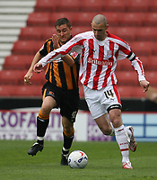 Photo: Pete Lorence.<br />Stoke City v Hull City. Coca Cola Championship. 21/04/2007.<br />Nicky Forster challenges Danny Higginbotham.