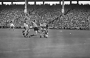 Down kicks under Kerry as he attempts grabs the ball from the ground during the All Ireland Senior Gaelic Football Final Kerry v Down in Croke Park on the 22nd September 1968. Down 2-12 Kerry 1-13.