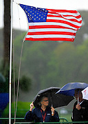 Spectators brace the wind and rain during the second round of the RBC Heritage golf tournament in Hilton Head Island, S.C., Friday, April 18, 2014. (AP Photo/Stephen B. Morton)