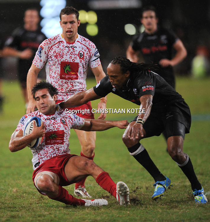 Rod Davies of the Reds, Odwa Ndungane of the Mr Price Sharks. <br /> &copy;Backpagepix