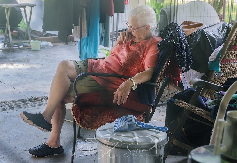 Homeowner Fay McDowell, of Zoar Baptist Church, rests on her patio as members of Southern Baptist Disaster Relief mud out her house, Aug. 22, 2016, in Baton Rouge, La. McDowell is one of thousands of Louisiana residents whose homes were damaged by flood waters, Aug. 12-15, 2016. Approximately 13 people died during the flood, and 20 parishes experienced severe damage. (Photo by Carmen K. Sisson)