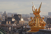 La Poesie or Allegory of Poetry, by Charles Gumery, 1827'??1871, gilded statue on the right avant-corps of the main facade of the Palais Garnier or Paris Opera, built 1861-75, in the 9th arrondissement of Paris, France. The statue is seen from behind from roof level looking out over the rooftops of Paris. Picture by Manuel Cohen