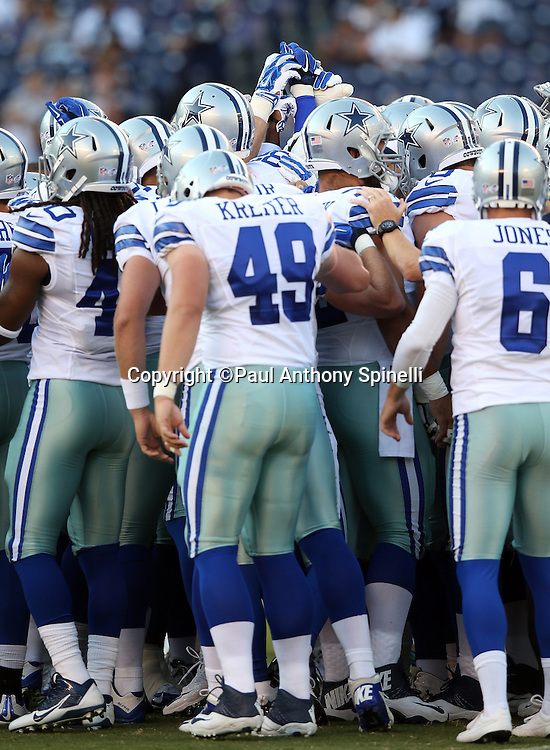 Dallas Cowboys join hands before the 2015 NFL preseason football game against the San Diego Chargers on Thursday, Aug. 13, 2015 in San Diego. The Chargers won the game 17-7. (©Paul Anthony Spinelli)