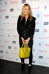 Image ©Licensed to i-Images Picture Agency. 10/06/2014. London, United Kingdom. Laura Whitmore arriving at the Superdrug 50th Anniversary Party at The Bankside Vaults, Southbank. Picture by Chris Joseph / i-Images