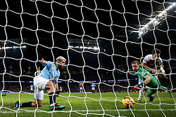 Manchester City's Sergio Aguero (left) scores his side's third goal of the game during the Premier League match at the Etihad Stadium, Manchester.