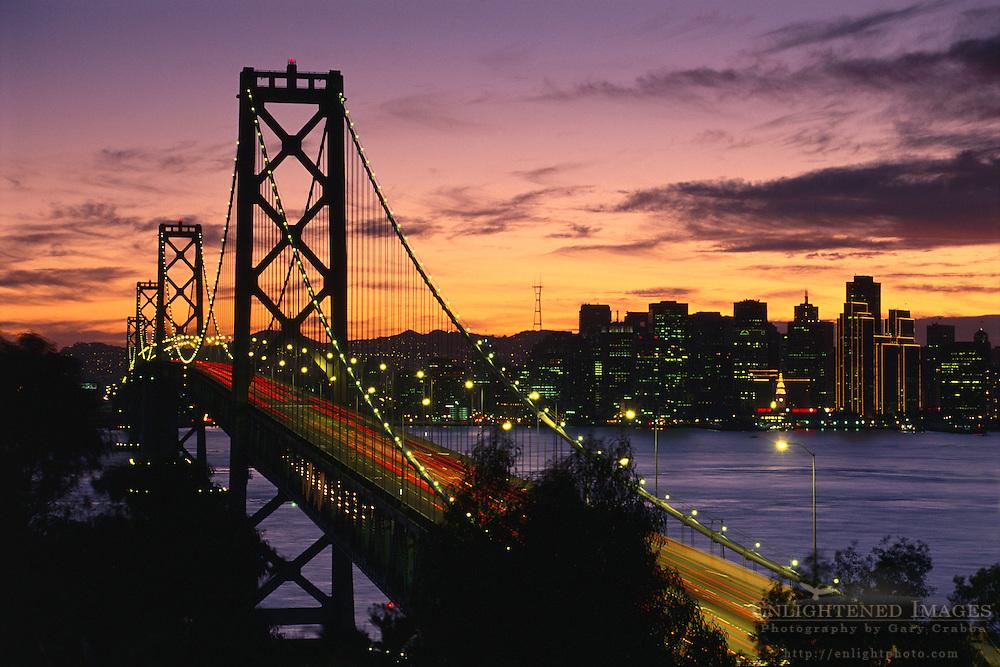 Sunset over the Oakland - San Francisco Bay Bridge and downtown San Francisco, California