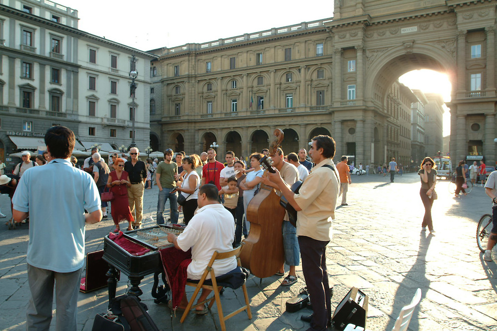 Musicians and tourists in Piazza in Rome, Italy