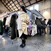Nederland, Amsterdam , 5 december 2010..Eef van Dunen staat model in haar eigen kleding van Eef's Elegant Fashion tijdens de Sunday Market in de hallen van de Westergasfabriek..Sunday Market selecteert deelnemers op creativiteit, spirit, schoonheid, humor, originaliteit, duurzaamheid, innovativiteit, maar ook als men 'gewoon wat leuks' te bieden heeft. ?De bedoeling is dat deelnemers alleen eigen ontwerp en/of makelij aanbieden, maar ook bijzondere collecties of verzamelingen kunnen meedoen..Oude bekenden en nieuwe deelnemers verkopenhun unieke producten.Je vindt er voor elk wat wils.Design,fashion, retro, crafty stuff,kinderkleding,schilderijen, handgemaakte zeep...?Alle producten worden aangeboden door de ontwerpers of makers zelf..Foto:Jean-Pierre Jans