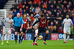 BOURNEMOUTH, ENGLAND - Saturday, December 8, 2018: Liverpool's Georginio Wijnaldum (L) and AFC Bournemouth's Joshua King during the FA Premier League match between AFC Bournemouth and Liverpool FC at the Vitality Stadium. (Pic by David Rawcliffe/Propaganda)