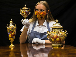 Bonhams Home and Interiors Sale Edinburgh. 06 July 2020 <br /> <br /> Pictured: Romey Clark from Bonhams with three post-war Royal Worcester Fruit painted vases and covers. Vase painted by J. Cool Estimate £500 - £700. Vase painted by Harry Ayrton Estimate £1,500 - £2,000. Vase painted by Freeman Estimate £500 - £700. The Bonhams Home and Interiors sale takes place on Thursday 9 July in Edinburgh. <br /> <br /> (c) Richard Dyson | EdinburghElitemedia.co.uk 2020