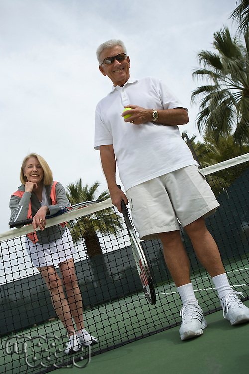 Man and woman on tennis court