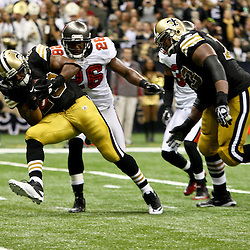 November 6, 2011; New Orleans, LA, USA; New Orleans Saints running back Pierre Thomas (23) runs for a touchdown past Tampa Bay Buccaneers safety Sean Jones (26) during the third quarter of a game at the Mercedes-Benz Superdome. Mandatory Credit: Derick E. Hingle-US PRESSWIRE