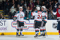 KELOWNA, CANADA - MARCH 27: Dillon Dube #19 celebrates a goal with Tyson Baillie #24 and Gage Quinney #20 of Kelowna Rockets on March 27, 2015 at Prospera Place in Kelowna, British Columbia, Canada.  (Photo by Marissa Baecker/Shoot the Breeze)  *** Local Caption *** Dillon Dube;Gage Quinney; Tyson Baillie;