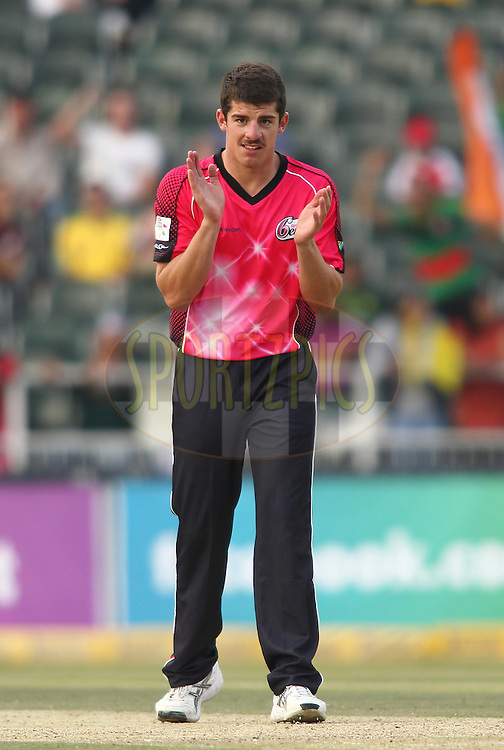 Moises Henriques of the Sydney Sixers celebrates Suresh Raina of the Chennai Super Kings wicket during match 3 of the Karbonn Smart CLT20 South Africa between Sydney Sixers and  and Chennai Super Kings held at The Wanderers Stadium in Johannesburg, South Africa on the 14th October 2012..Photo by Shaun Roy/SPORTZPICS/CLT20