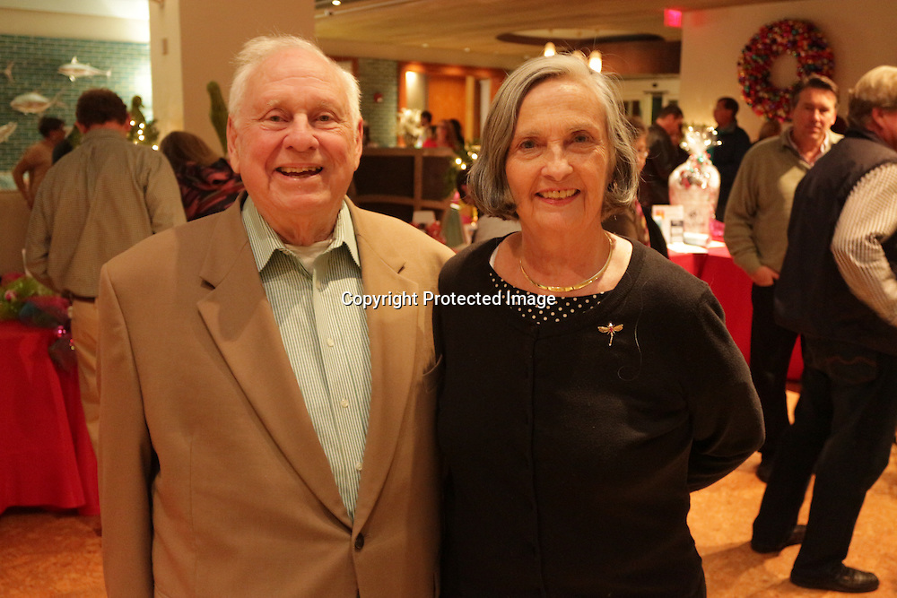 John Cameron, left, and Judith Cameron pose for a photo Friday November 28, 2014 during the Atlantic Marine Holiday Flotilla Launch Party. (Jason A. Frizzelle)