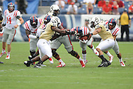 Ole Miss Rebels running back Jaylen Walton (6) vs. Vanderbilt Commodores linebacker Darreon Herring (35) and Vanderbilt Commodores linebacker Nigel Bowden (52) at L.P. Field in Nashville, Tenn. on Saturday, September 6, 2014. Ole Miss won 41-3.